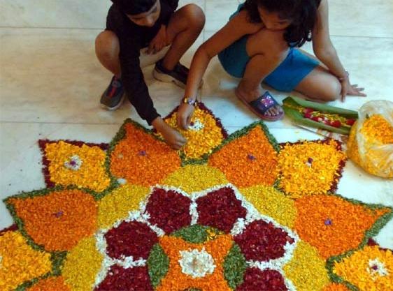 small-kids-making-rangoli-with-flowers