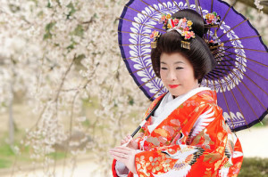 The bride wears a traditional wedding dress called Kimono.
