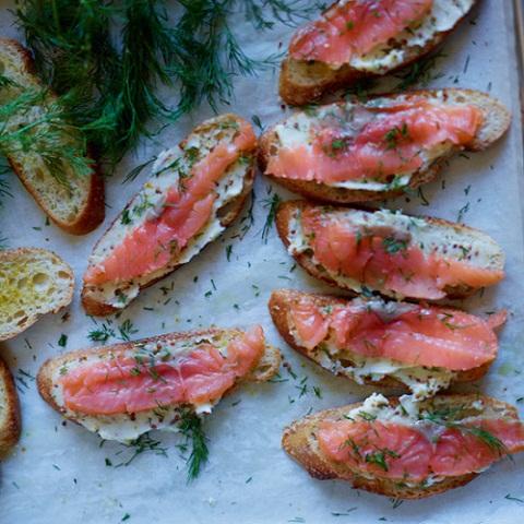 David Tanis preparing salmon toast in kitchen. LeeHudson_Thanksgiving_FW_Nov2012